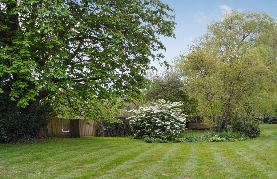 The large lawned garden at Troggs End in Oxted