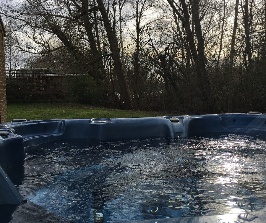 You have a large private outdoor hot tub at Waters Edge, Pentney Lakes
