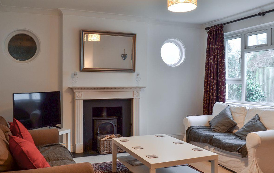 The living room with a wood burning stove at Waverley Reach in Hamble