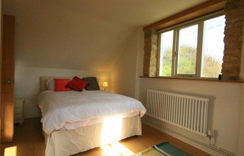One of the two bedrooms at Westfield Barn near Burford