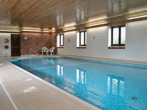The swimming pool at Wheel Farm Cottages, Devon
