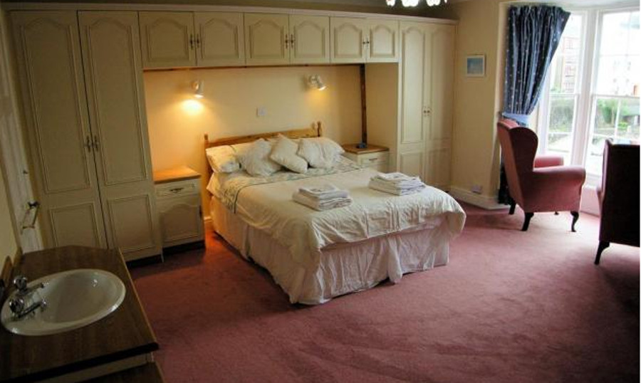 One of the four bedrooms at White House in Tenby
