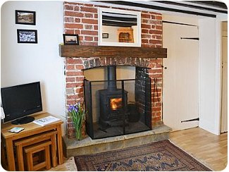 A cosy evening in with the wood burning stove<br /> at Wingate Cottage
