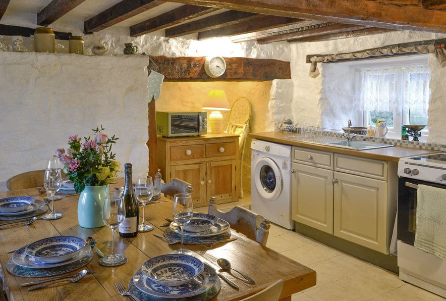 The kitchen and dining area at Wren Cottage in Prestatyn
