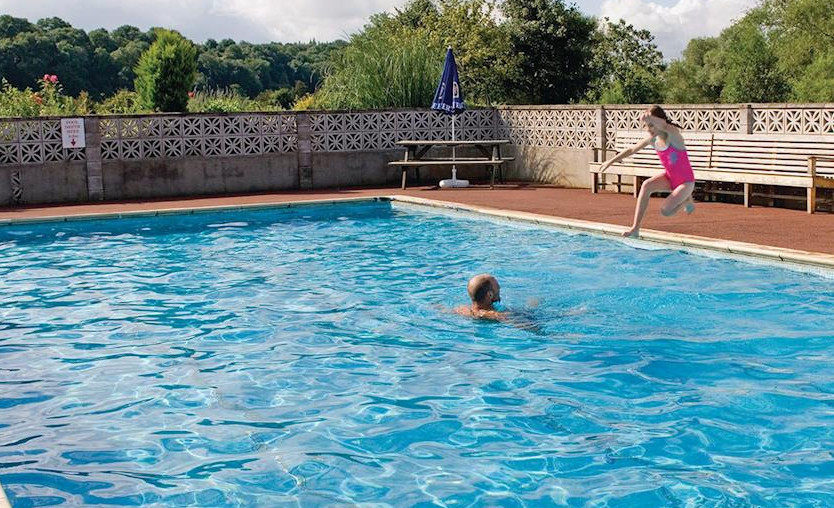 Enjoy a summer splash in the pool at Abbots Salford Park