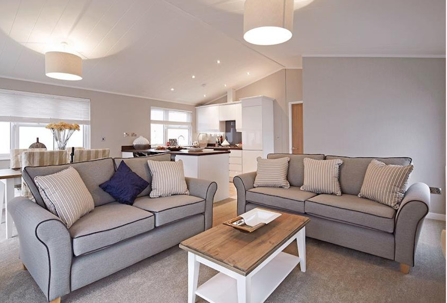 The open plan living room, kitchen and dining area in a lodge at Brokerswood Holiday Park