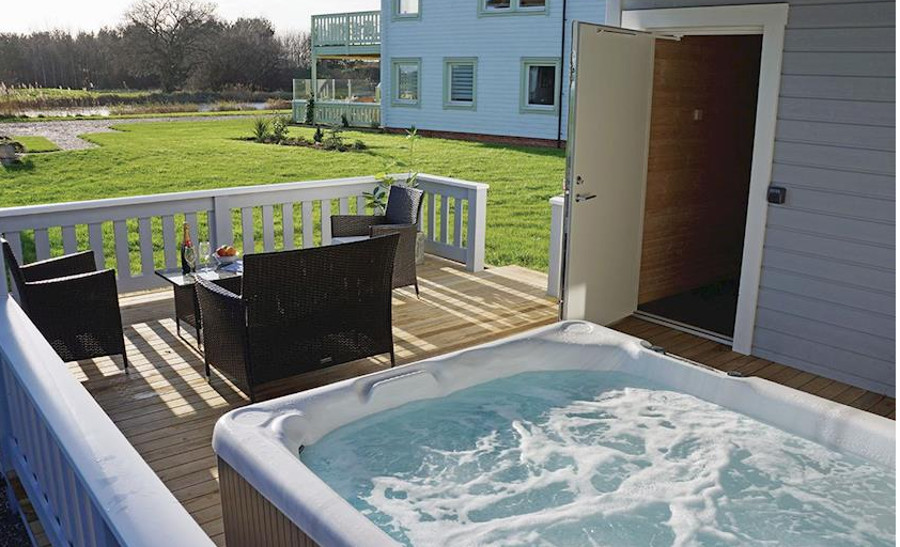 Private outdoor hot tub at a lodge in Caldecott Hall Golf and Spa