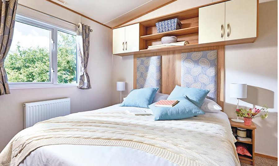 A bedroom in the Cheviot Deluxe Caravan at Forget Me Not Country Park