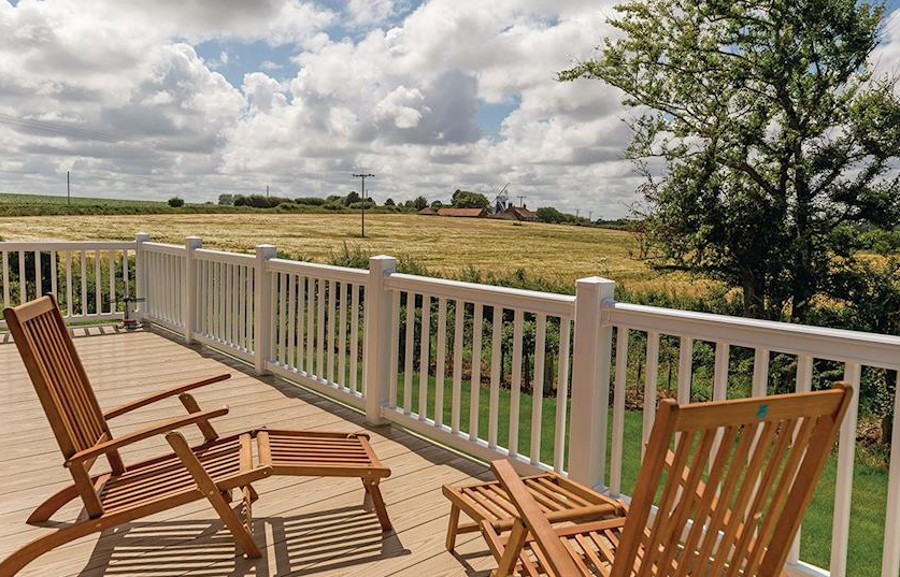 The lodges at Mundesley Holiday Village have a veranda with views of the Norfolk countryside
