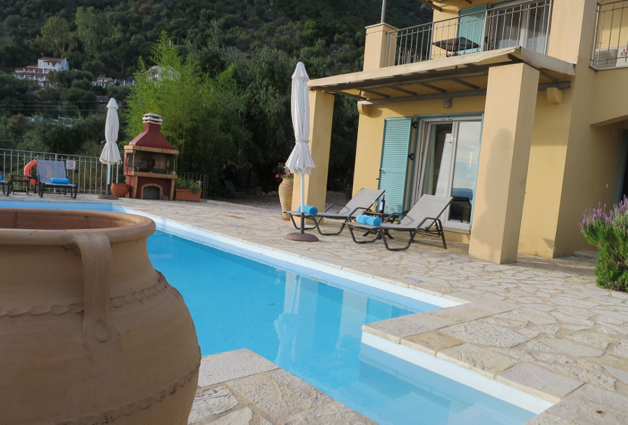 Villa Odele has a pool set into the paved garden
