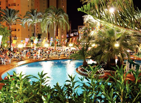 Swimming pool at night, at Palm Beach Hotel in Benidorm